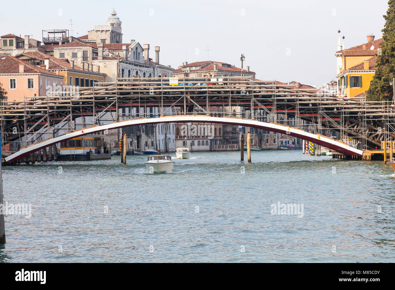 Accademia Bridge covered in scaffolding for renovations by Luxottica Eyewear, Grand Canal, Venice, Veneto,  Italy - Stock Image