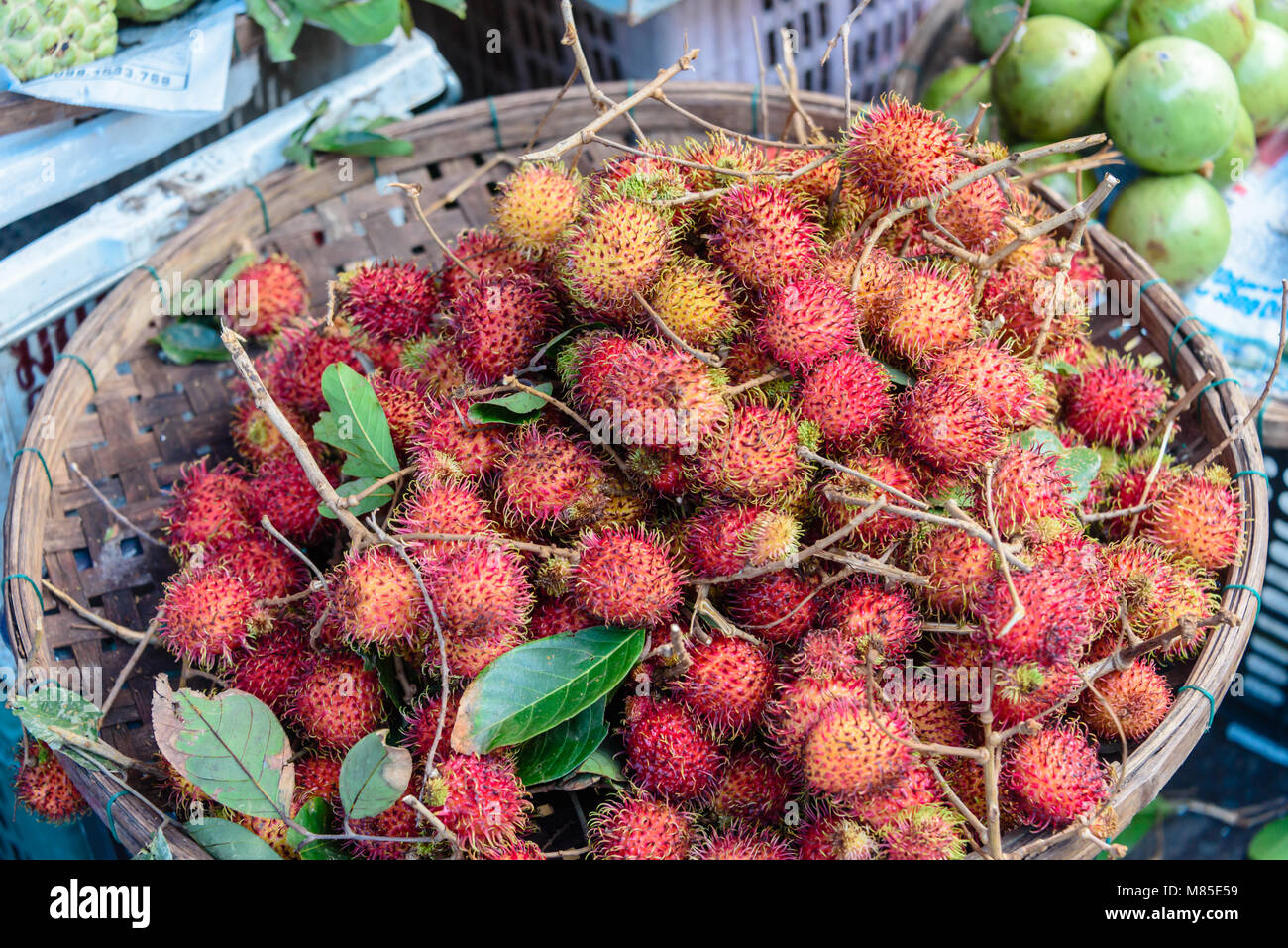 Lychees for sale at an outdoor market, Hoi An, Vietnam - Stock Image