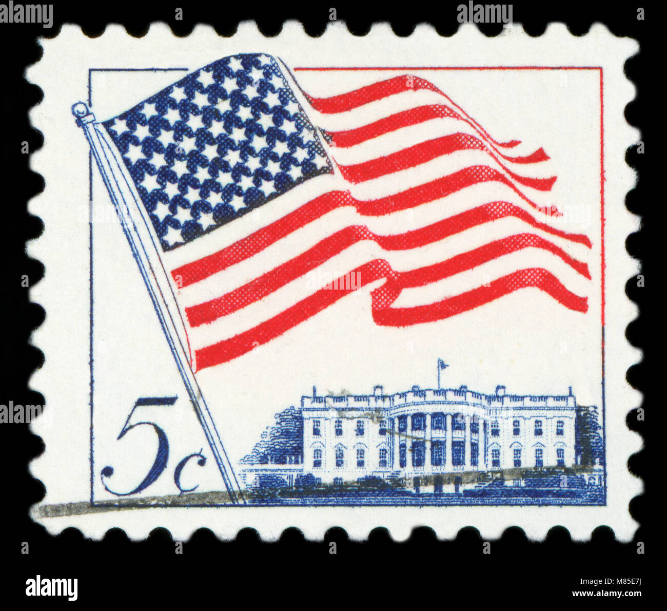 815abefd6f6c UNITED STATES OF AMERICA - CIRCA 1962  A used postage stamp from the USA  depicting an illustration of the American flag and White House in Washington