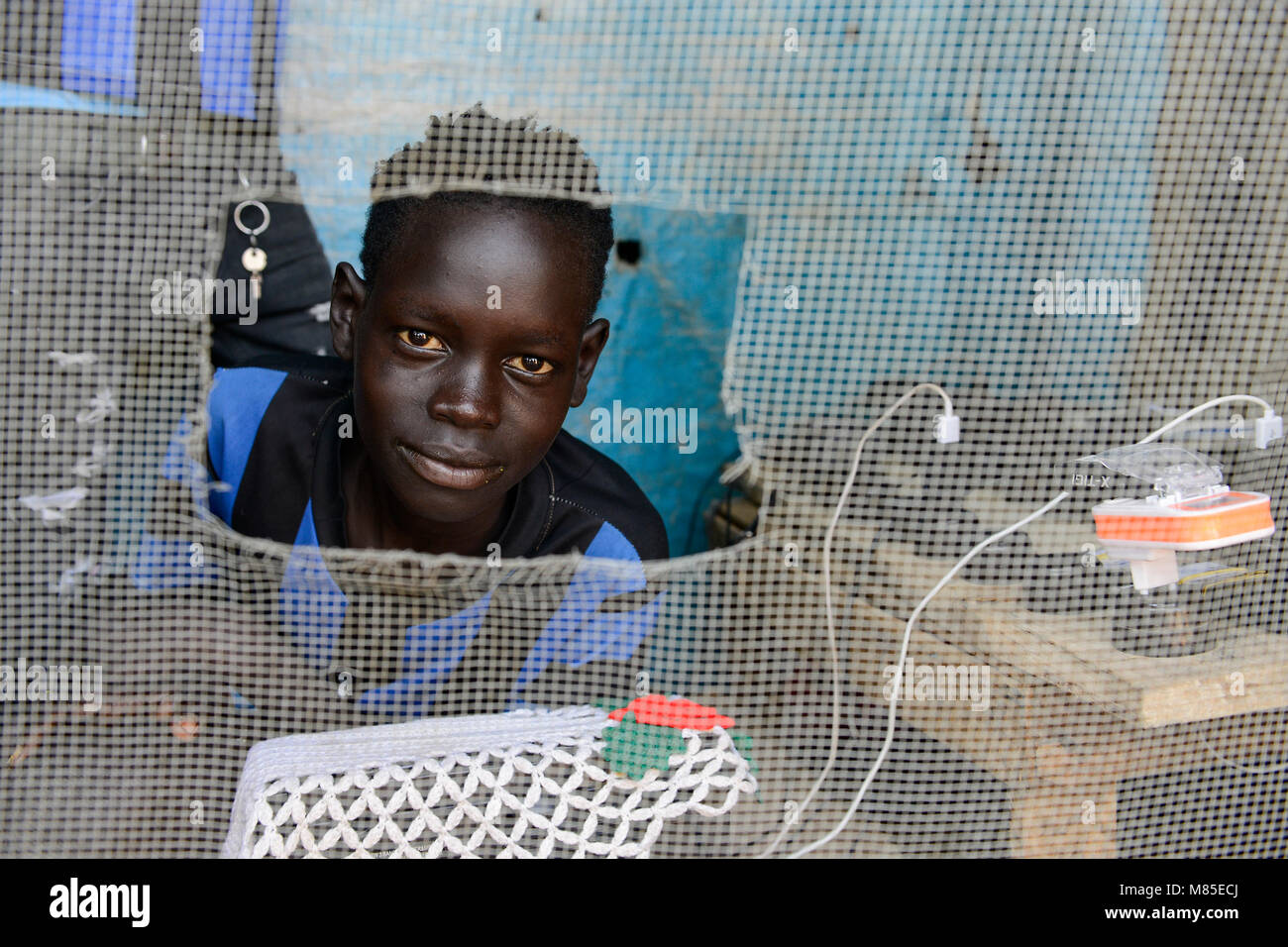 ETHIOPIA, Gambela, Itang, village Braziel, mobile phone battery recharge shop/ AETHIOPIEN, Gambela, Region Itang, - Stock Image