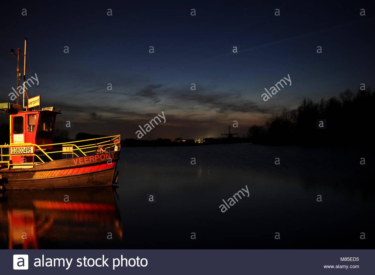 Ferryboat in the evening near Leiden, Netherlands - Stock Image