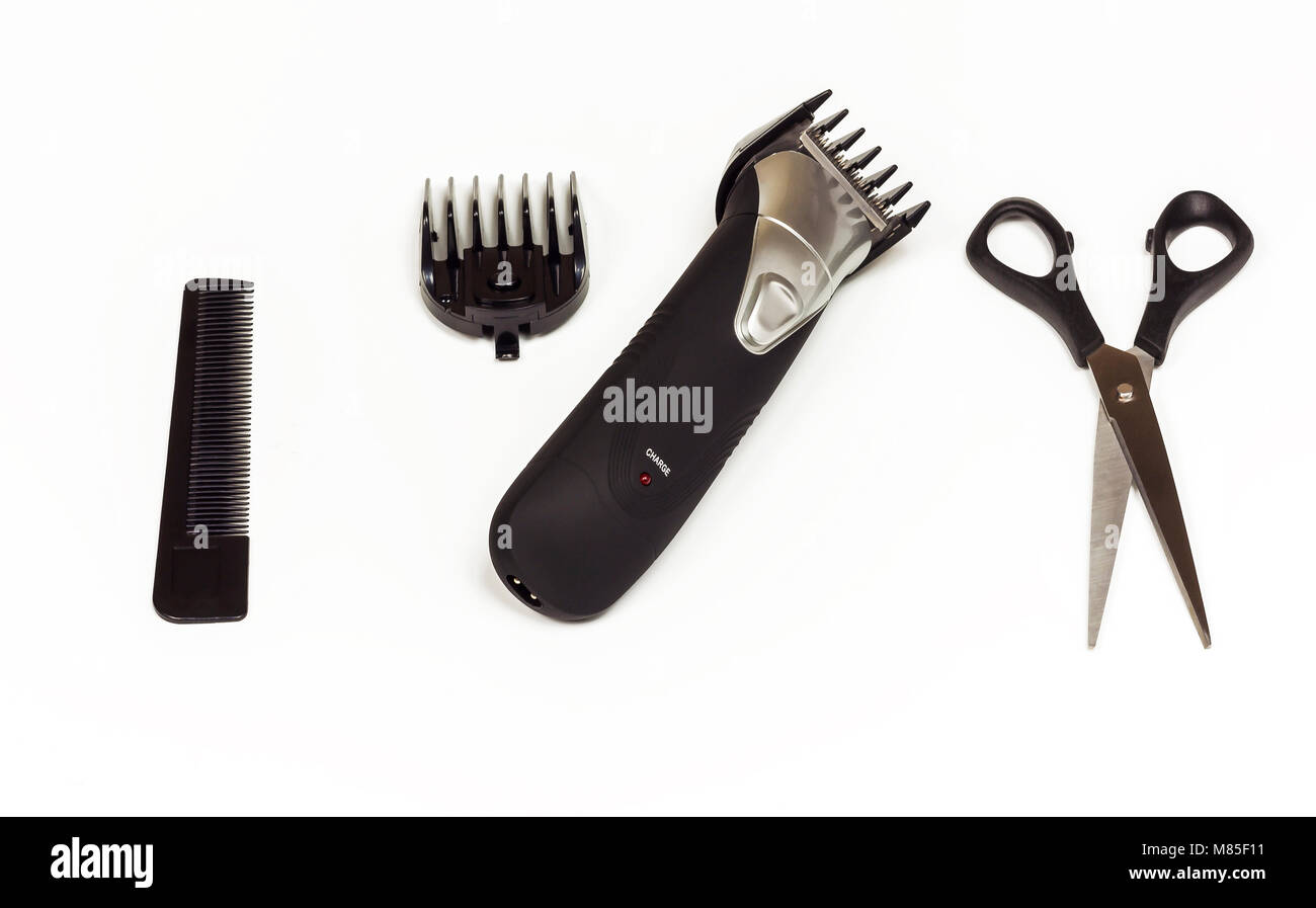 Hair clipper with nozzle, scissors and comb on white background - Stock Image