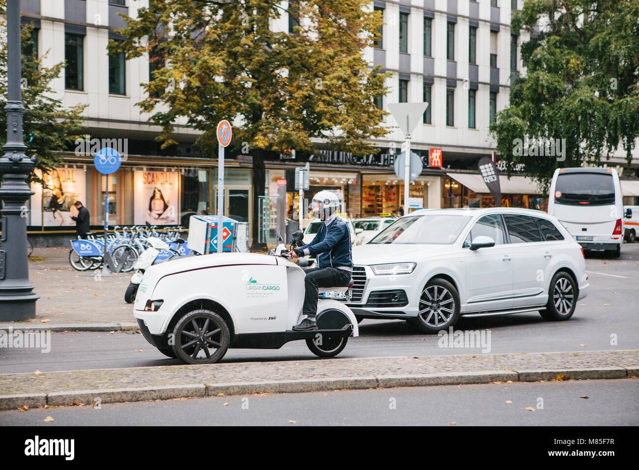 Postal delivery on eco friendly transport Urban Cargo in Germany - Stock Image