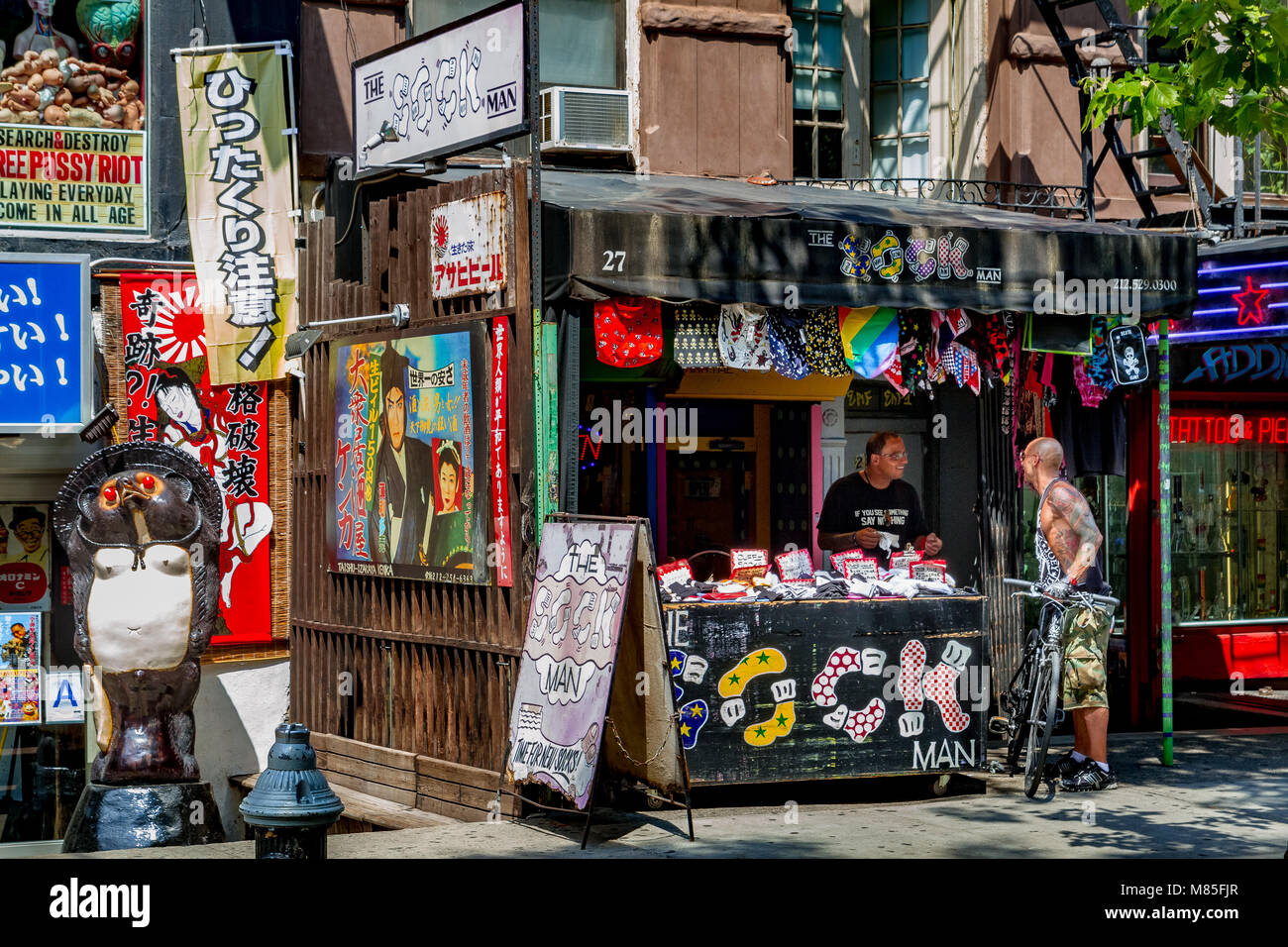 Man selling socks at a sock store in St Marks Place In The East Village ,Manhattan ,New York City - Stock Image