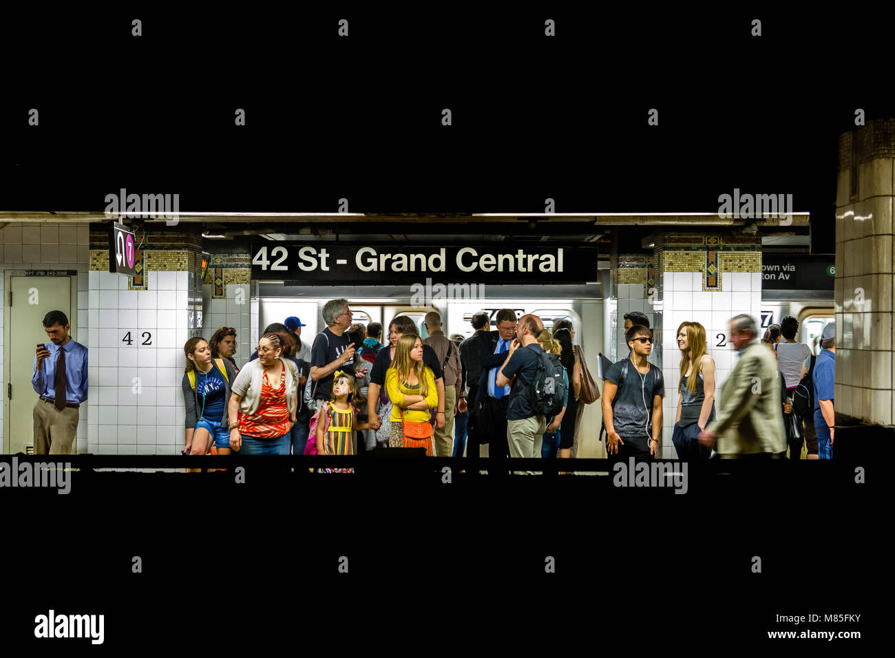 People on waiting for a subway train on 42nd street station , New York City - Stock Image