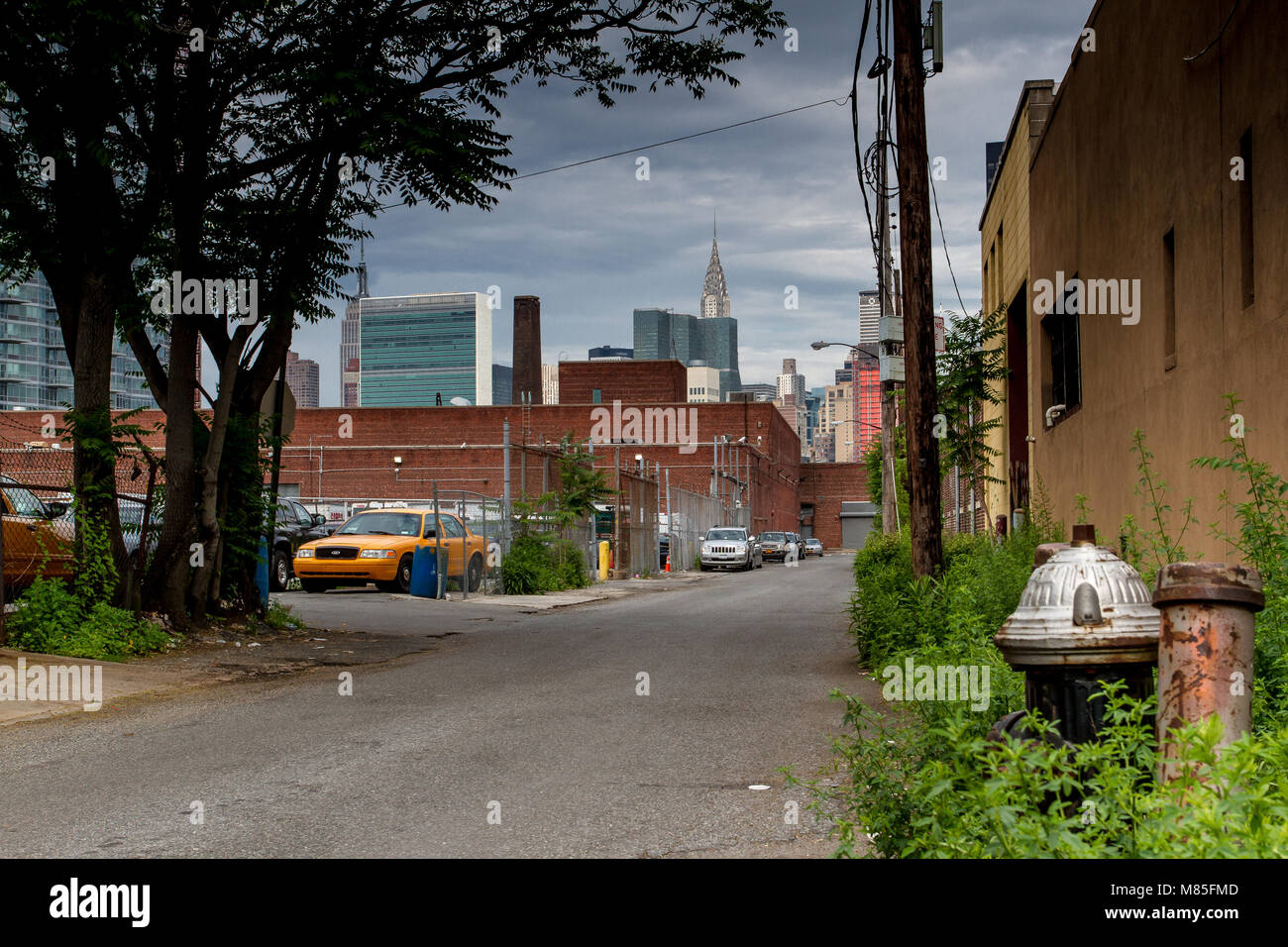 Fire Hydrant in a Long Island city industrial park looking towards Manhattan with the Chrysler Building & The - Stock Image