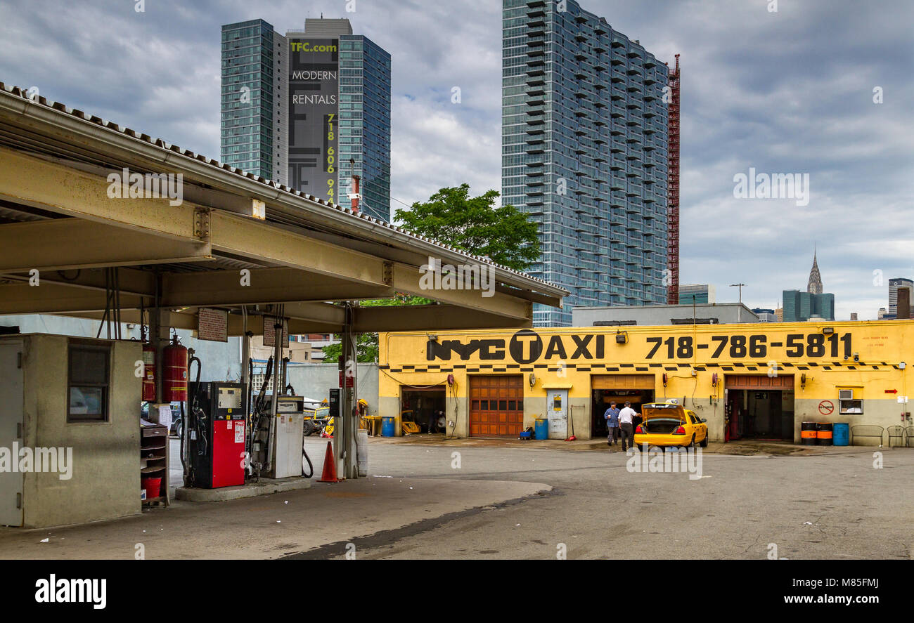 Yellow medallion taxi Garage and gas station with The Chrysler Building in the Distance, Long Island City , Queens - Stock Image