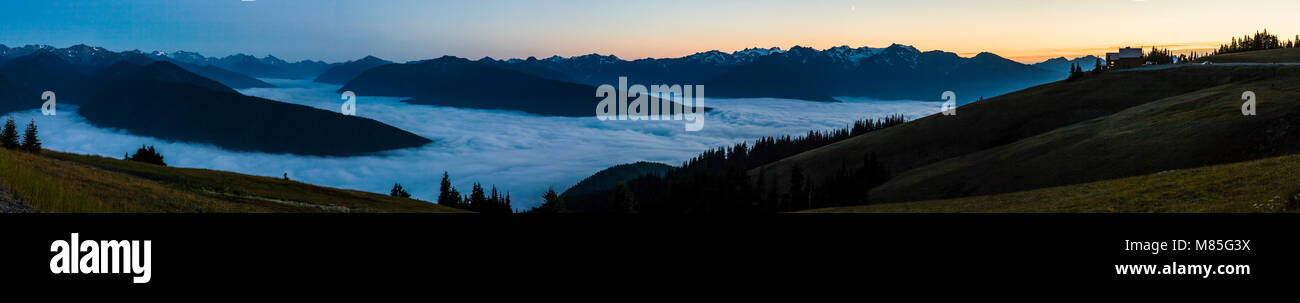 The view at dusk from Hurricane Ridge visitors center. The valleys below filled with clouds. Olympic National Park, Stock Photo