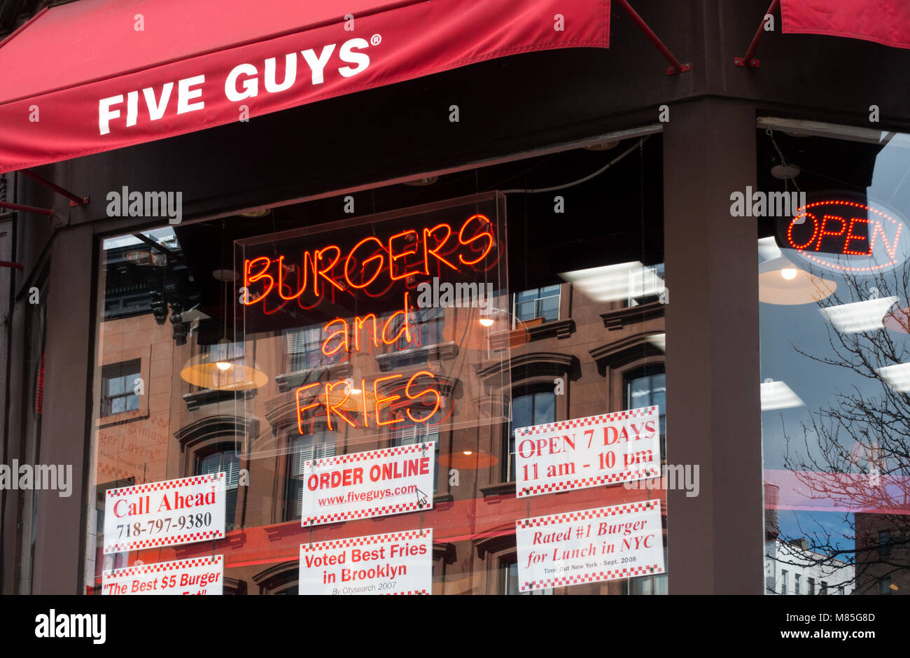 Window display and signs at Five Guys in Brooklyn Heights - Stock Image