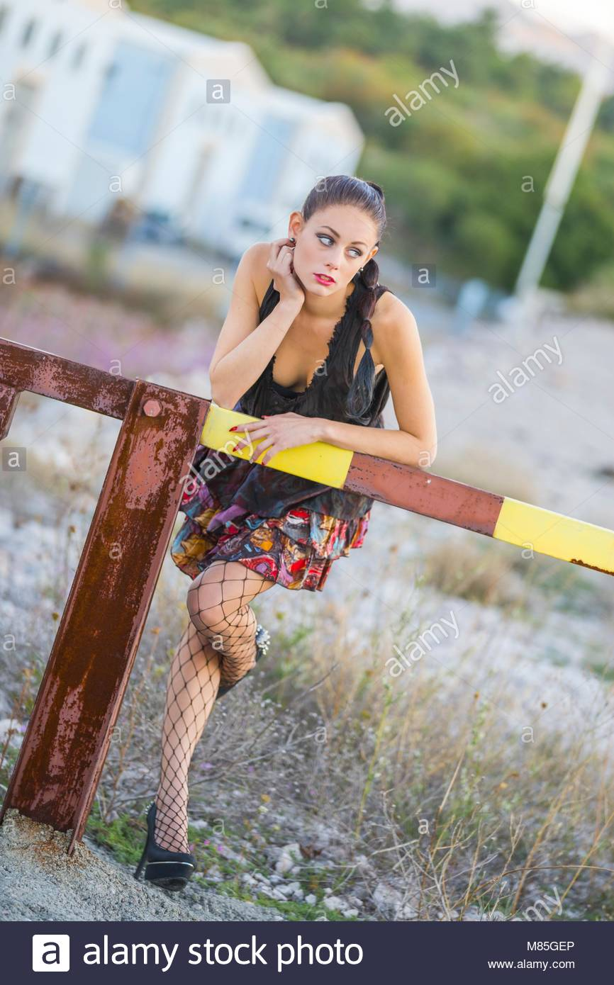 One pretty teenager girl only fishnet pantyhose stockings model-released release alpfabet Stock Photo