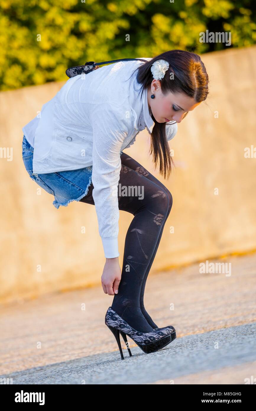 One pretty teenager girl only legs heels indisposed single solo - Stock Image