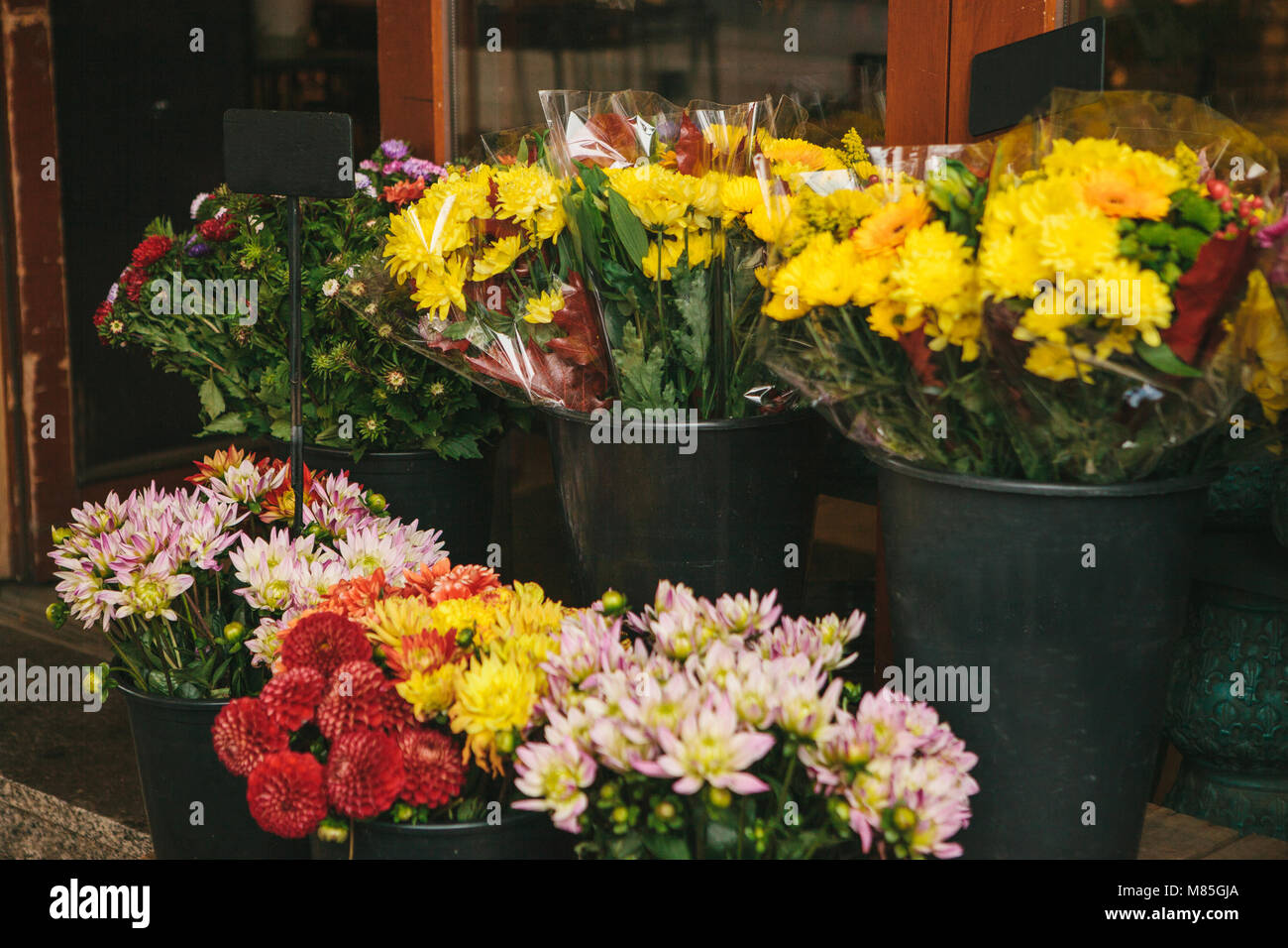 Street shop of flowers bouquets of peonies and chrysanthemums street shop of flowers bouquets of peonies and chrysanthemums stand in black buckets izmirmasajfo