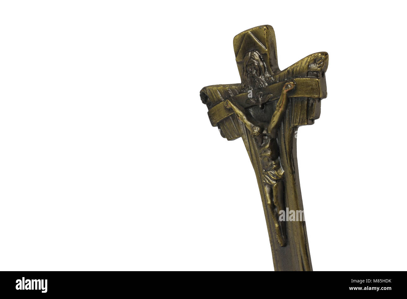 Cross brass with statue of Jesus, empty space on the left, close up view - Stock Image