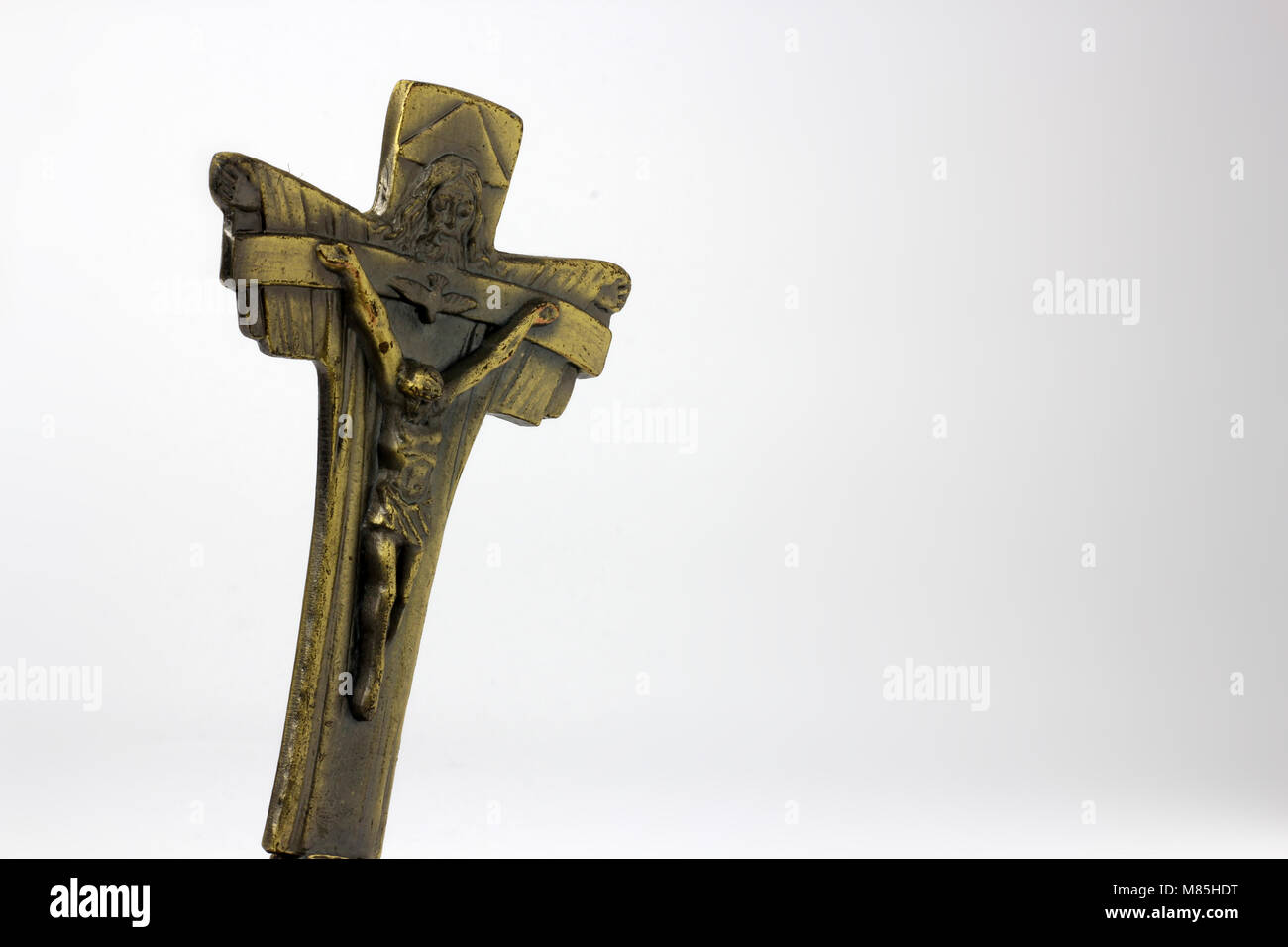 Cross brass with statue of Jesus, empty space on the right - Stock Image
