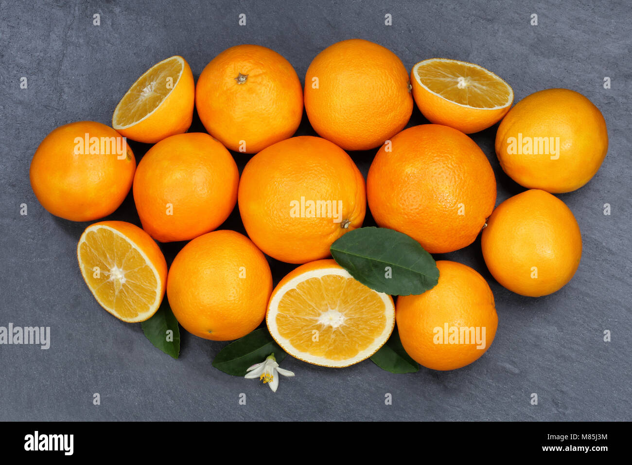 Oranges orange fruits slate top view from above - Stock Image