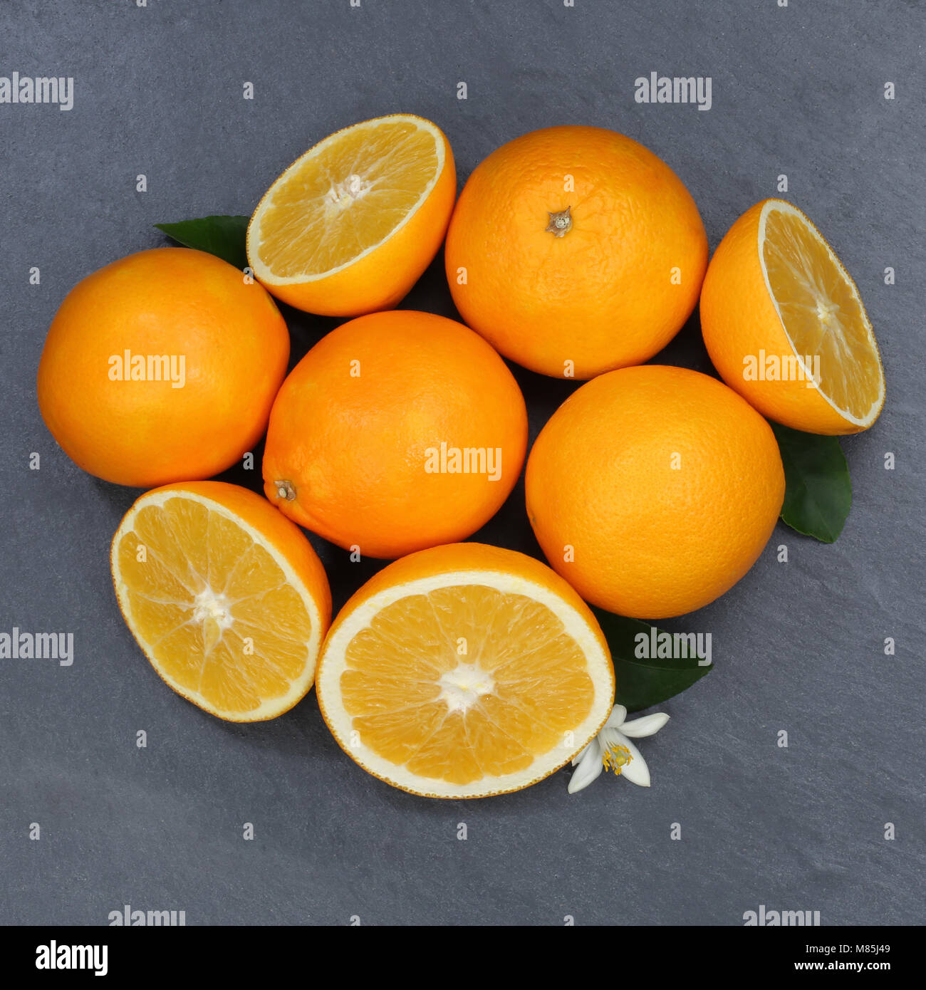 Oranges orange fruits slate square top view from above - Stock Image
