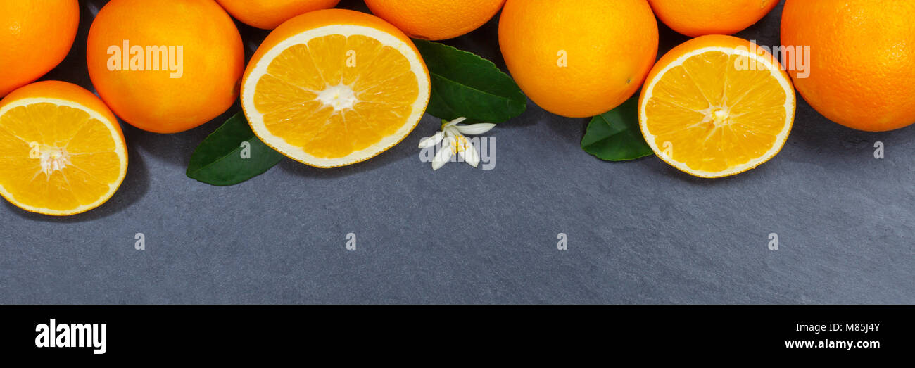 Oranges orange fruits slate copyspace banner top view from above - Stock Image
