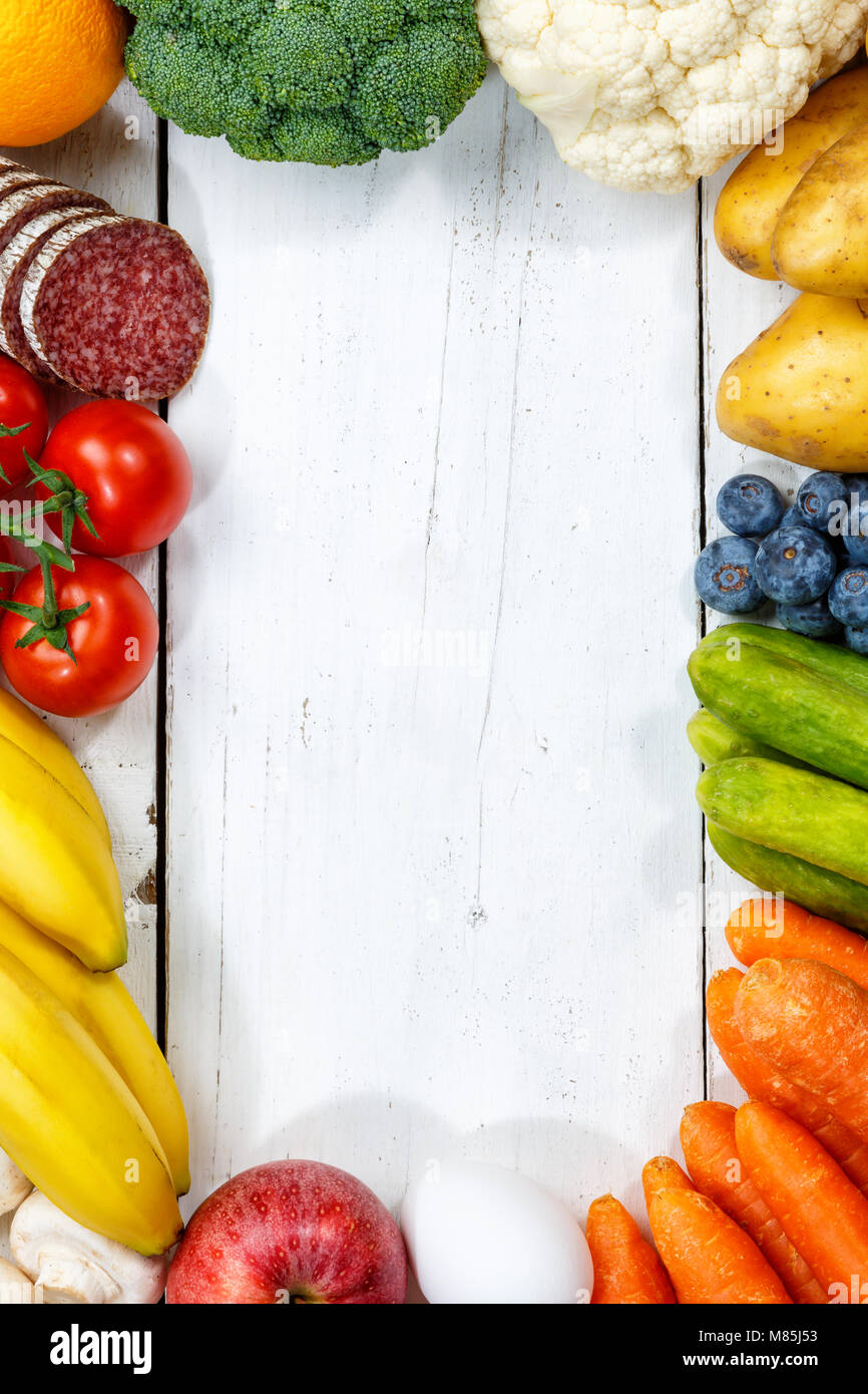 Fruits and vegetables food collection cooking frame portrait format copyspace top view from above - Stock Image