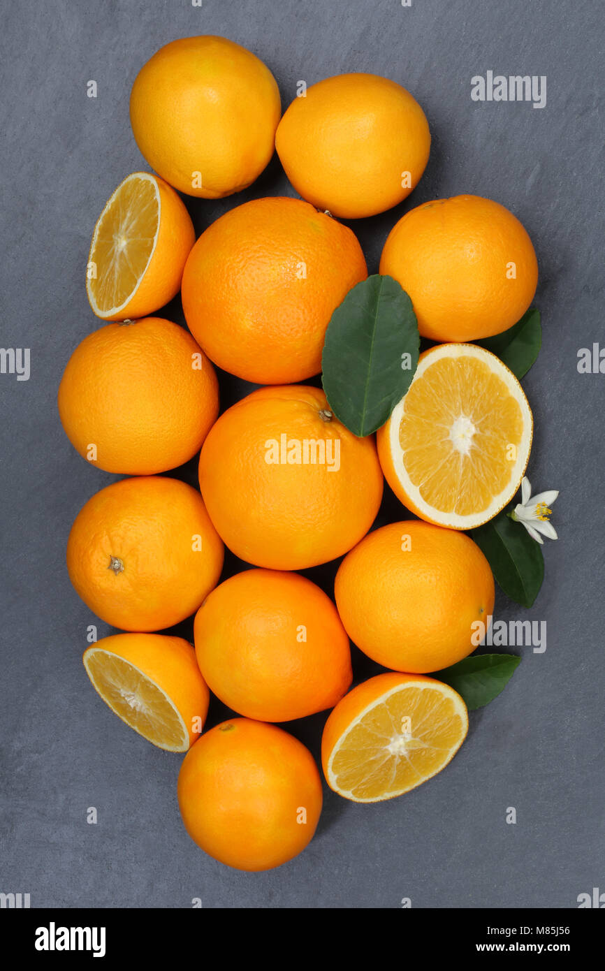 Oranges orange fruits slate portrait format top view from above - Stock Image