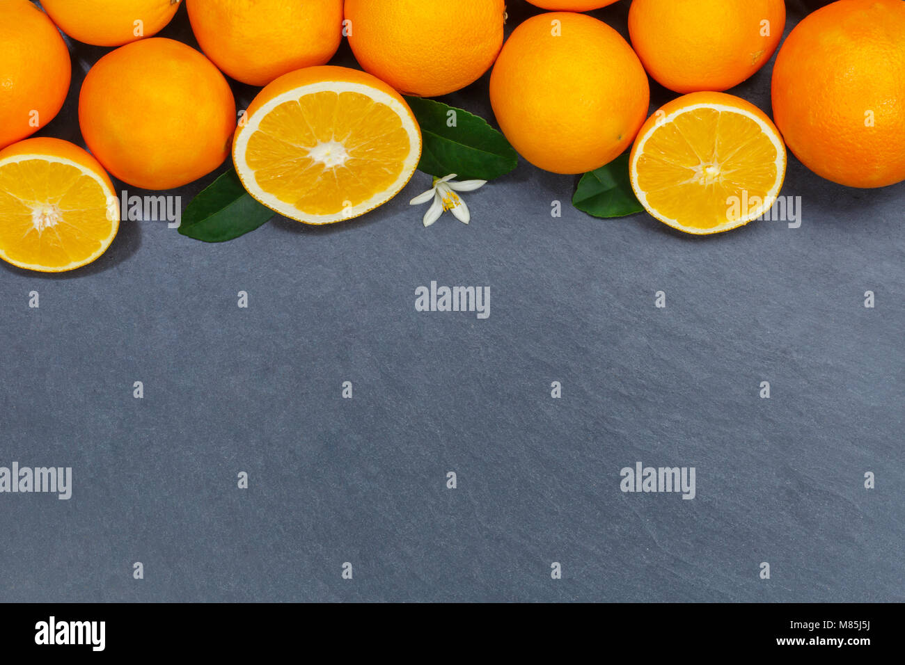 Oranges orange fruits slate copyspace top view from above - Stock Image