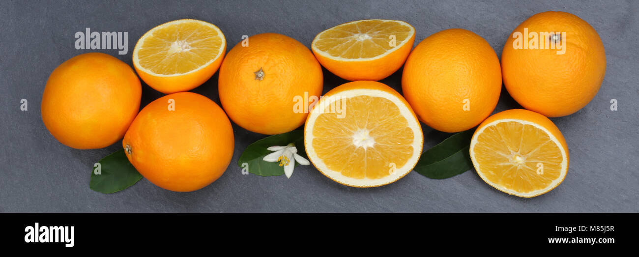 Oranges orange fruits slate banner top view from above - Stock Image