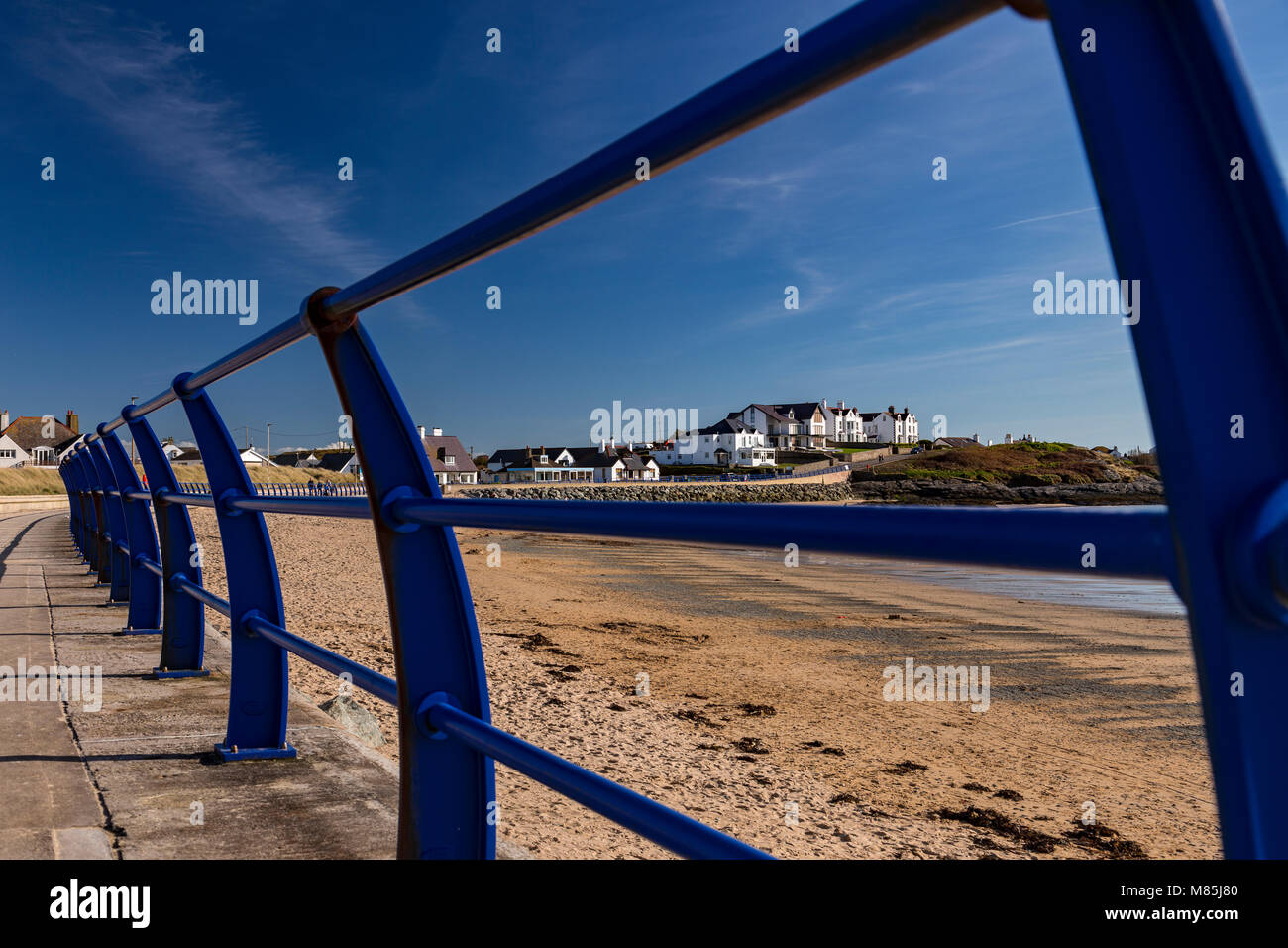 Railings on the promenade at Trearddur Bay, Anglesey on the North Wales coast - Stock Image