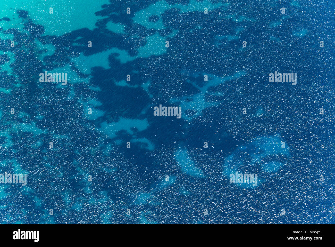 Aerial image of Mediterranean abstract blue water with big transparency near the coast of Isola di Pianosa Stock Photo
