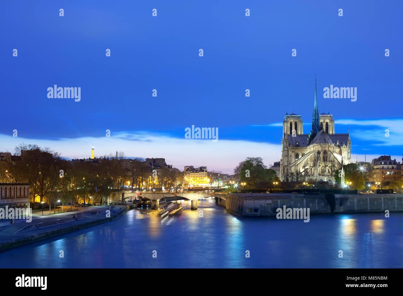 Notre Dame Cathedral on Ile de la Cite and Pont de l'Archeveche bridge over the Seine River, Paris, France Stock Photo
