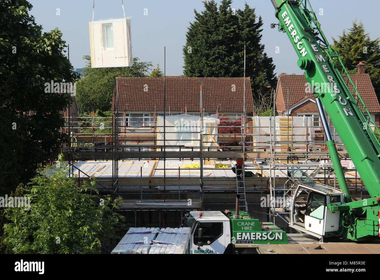 Crane Hoisting a Structural Insulated Panel (SIP) - Stock Image