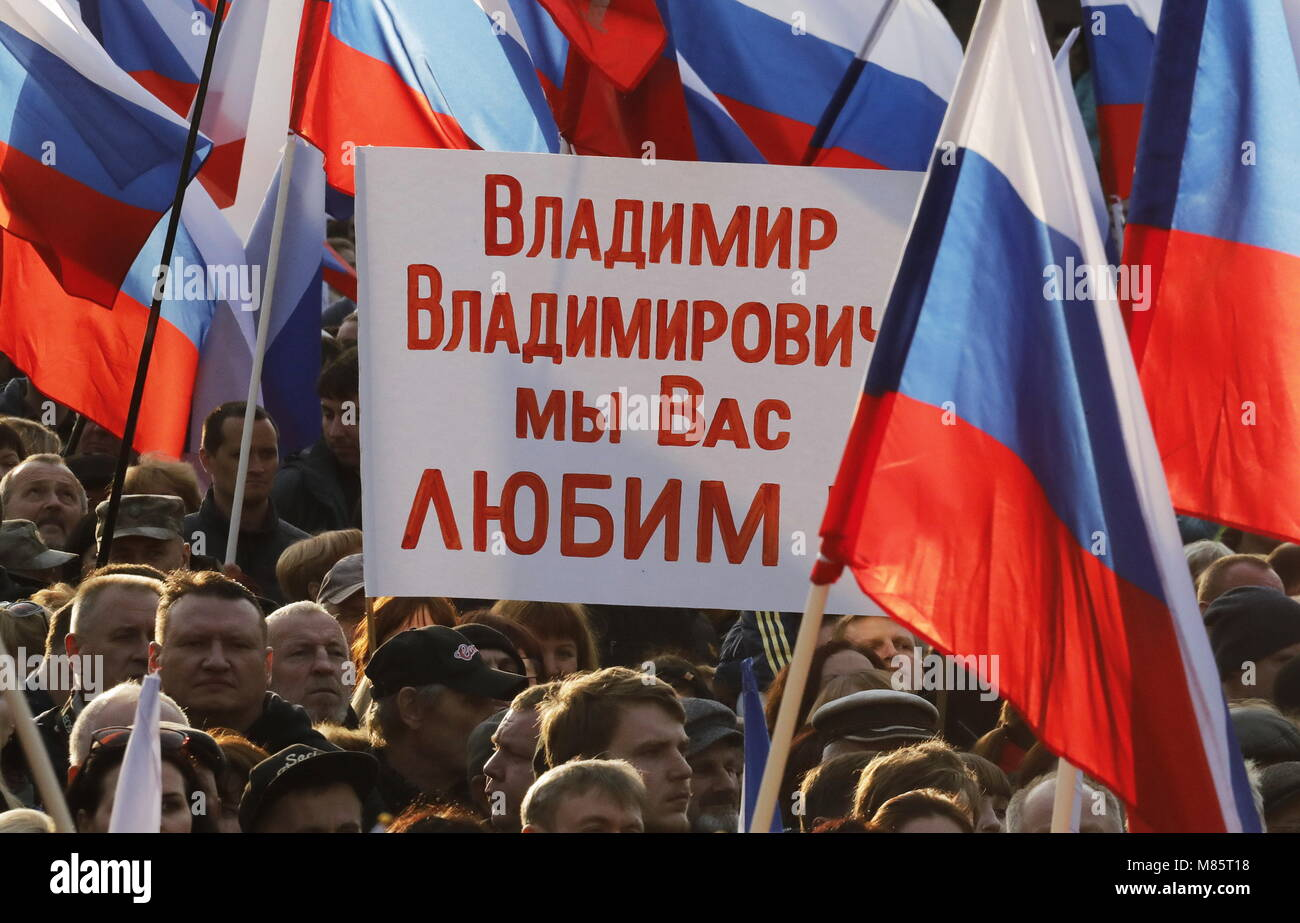 Sevastopol, Russia. 14th Mar, 2018. SEVASTOPOL, CRIMEA, RUSSIA - MARCH 14, 2018: Holding a sign reading 'Vladimir - Stock Image