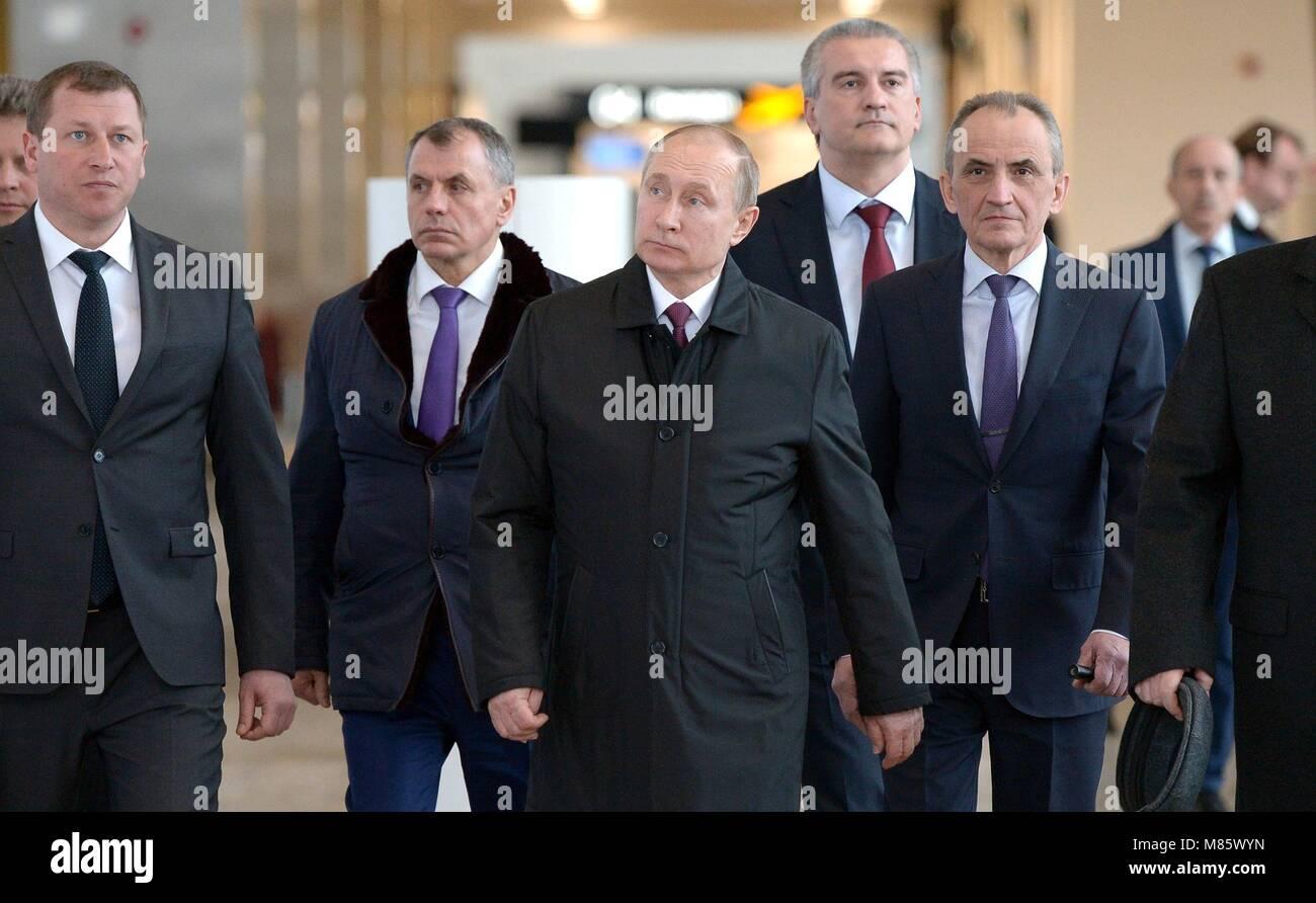 Russian President Vladimir Putin tours the new passenger terminal of Simferopol International Airport March 14, - Stock Image