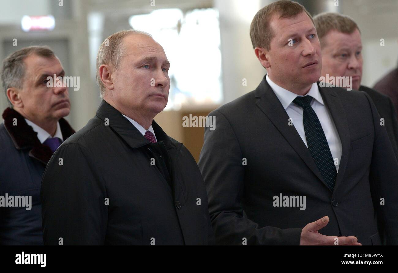 Russian President Vladimir Putin tours the new passenger terminal of Simferopol International Airport with Airport - Stock Image