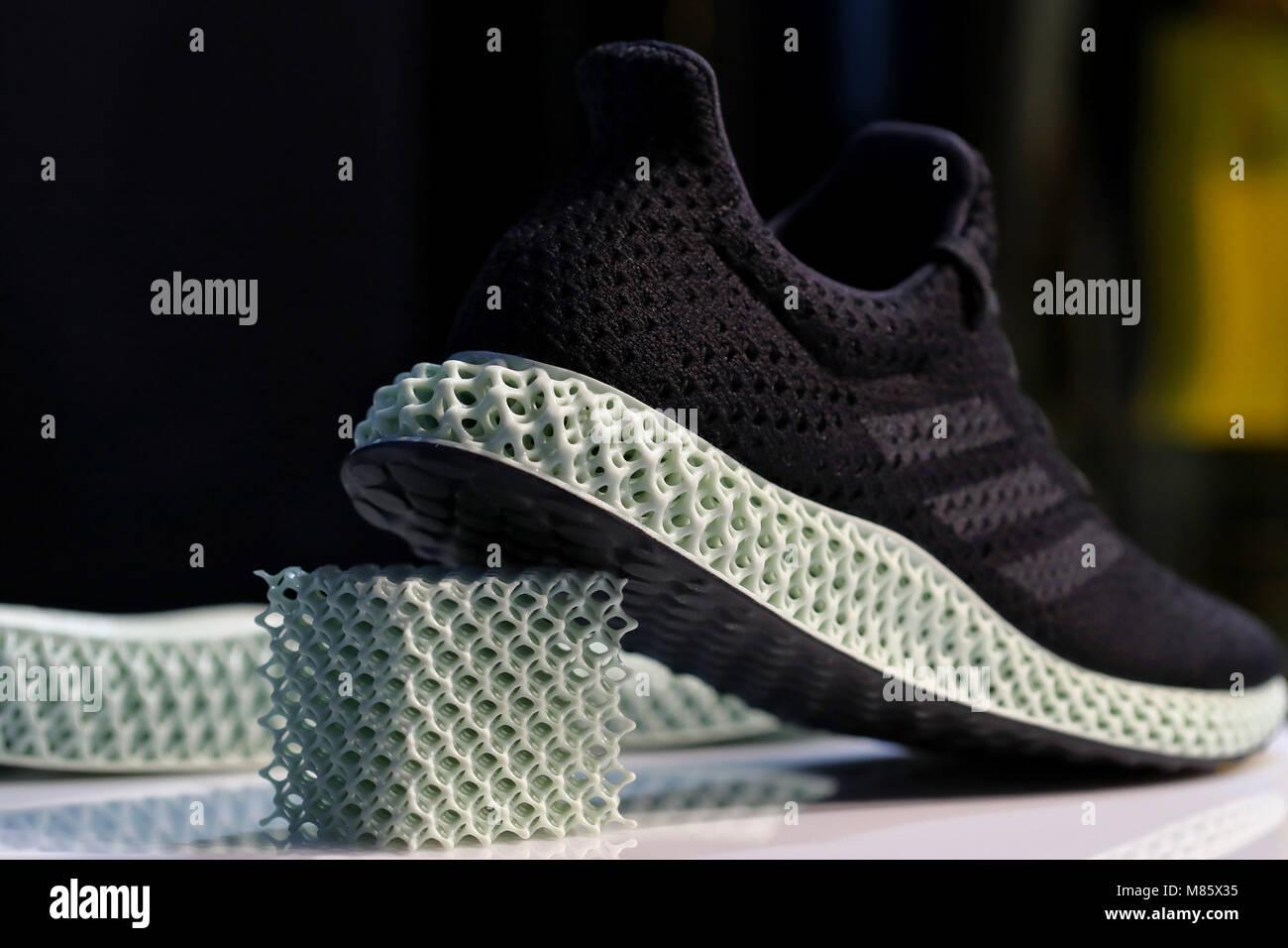 9bc2b3cb 14 March 2018, Germany, Herzogenaurach: The adidas logo on a shoe with a