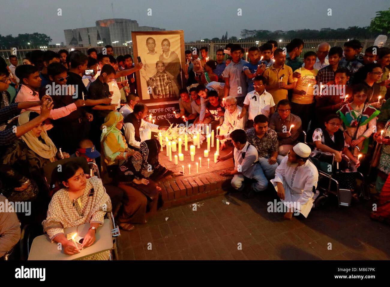 """DHAKA, BANGLADESH – MARCH  15, 2018: """"Protibondhi nagorik shangathaner parishad"""" organised a candlelight vigil at Stock Photo"""