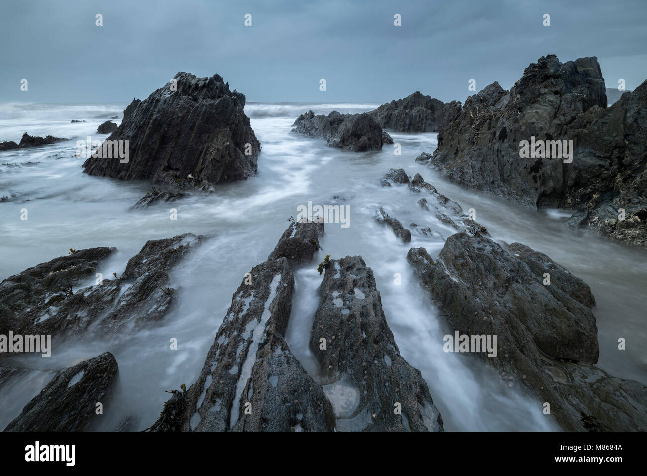 Rocky seashore at Bantham in the South Hams, Devon, England.  Winter (March) 2018. - Stock Image