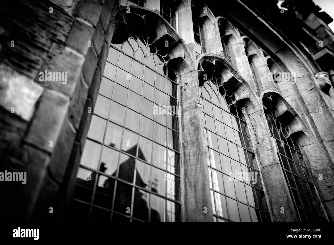 Historic Gothic Leaded And Decorative Arched Windows In An Ancient Church Demonstrating Tradional Medieval Architecture