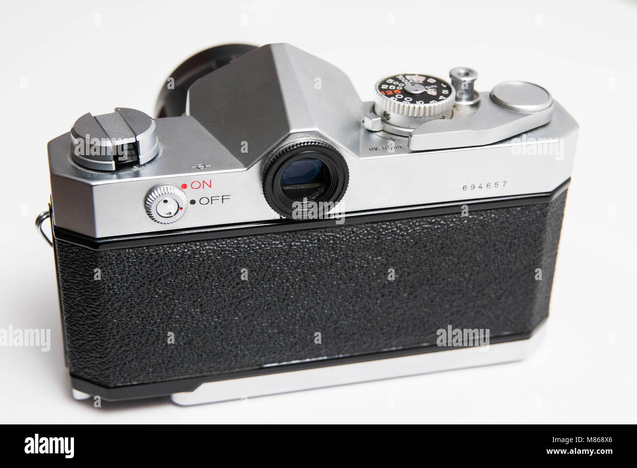 Old 35 mm camera isolated on white close up - Stock Image