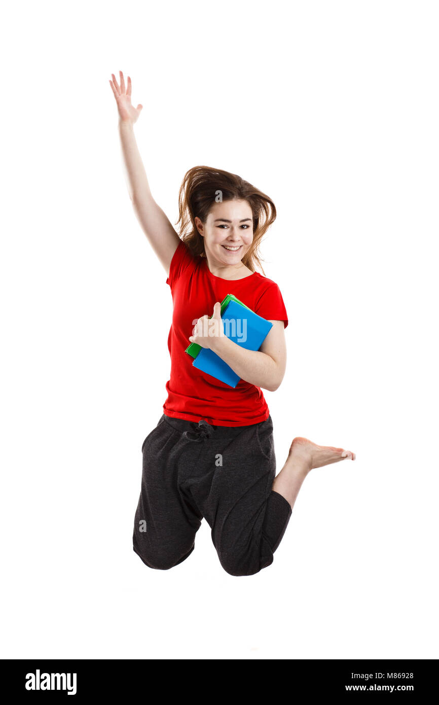 Young woman jumping on white background - Stock Image
