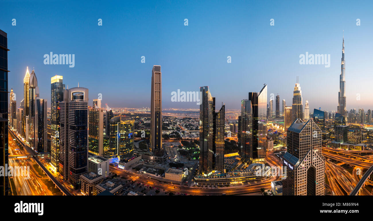 Cityscapes by day and night, featuring Singapore or Dubai.  For Singapore, featuring Marina Bay Sands by the Harbour. Stock Photo