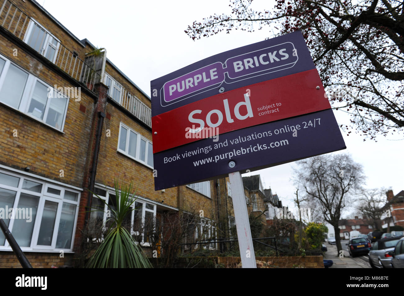 A Purple Bricks sold estate agent sign outside a house in Muswell Hill, London - Stock Image