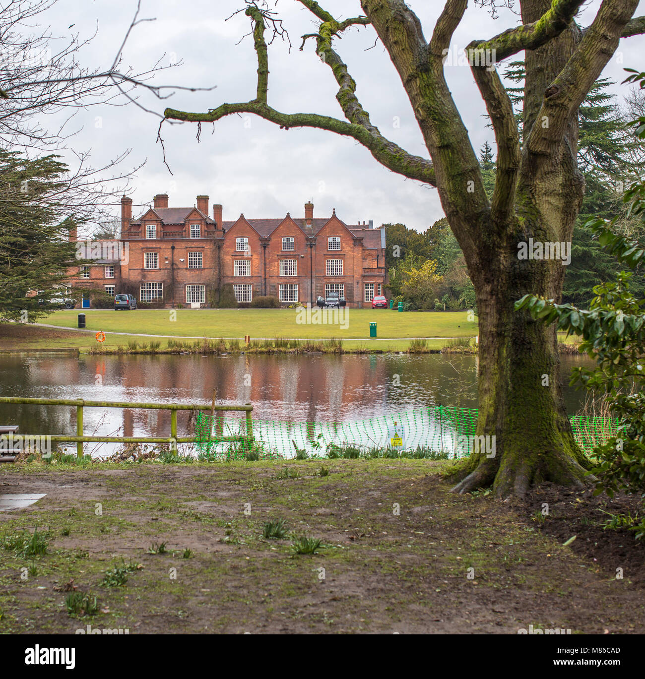 The buildings of the Reaseheath Agricultural College new nantwich in Cheshire viewed across the lake - Stock Image
