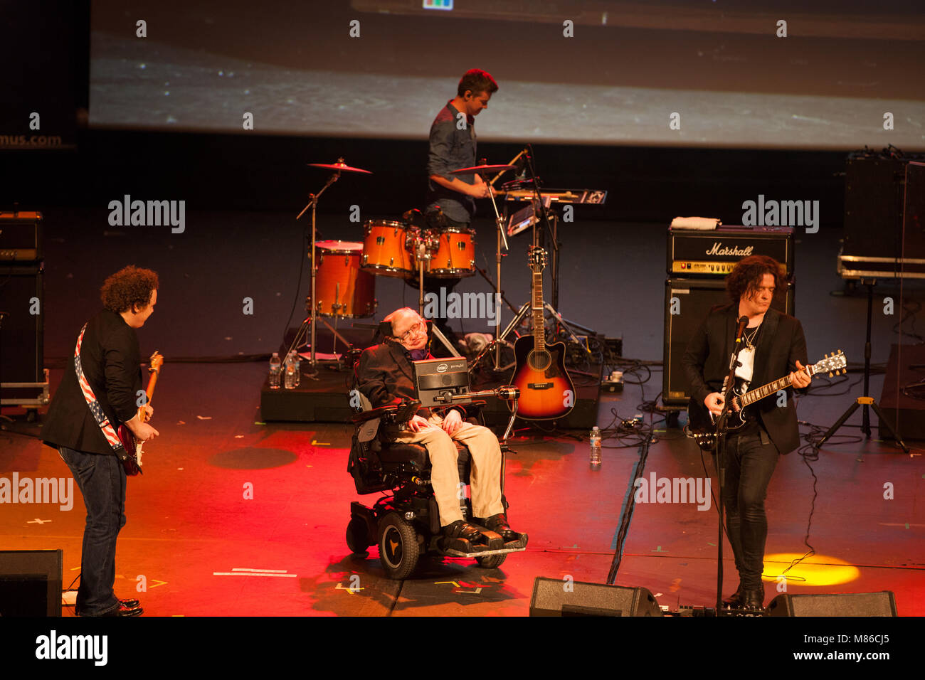 Prof. Stephen Hawking, British scientist, world renowned physicist on stage with Anathema, british rock group, playing Stock Photo