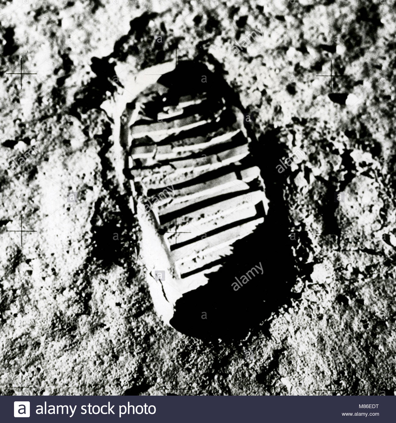 Neil Armstrong put his left foot on the rocky Moon. The Eagle has landed. Eagle was the name of the Lunar Module. - Stock Image