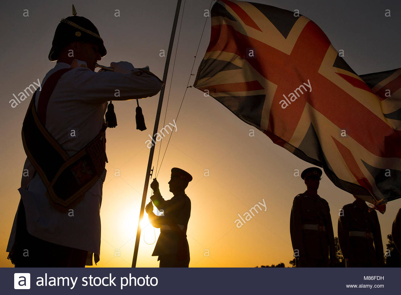 Sunset Ceremony in Episkopi. Pictured are personnel from Episkopi Garrison in Cyprus lowering the Union Jack on Stock Photo
