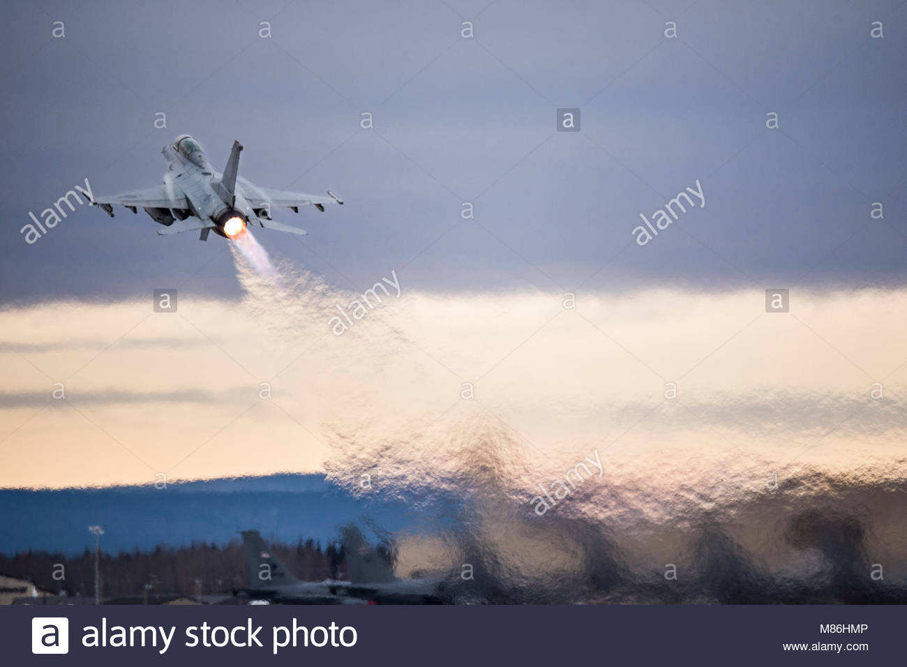 A Republic of Korea Air Force F-16 Fighting Falcon fighter aircraft takes off for a sortie from Eielson Air Force Stock Photo