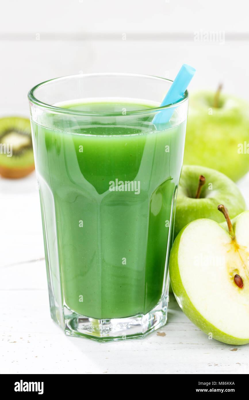 Green smoothie juice apple kiwi spinach glass portrait format fruit fruits fresh - Stock Image