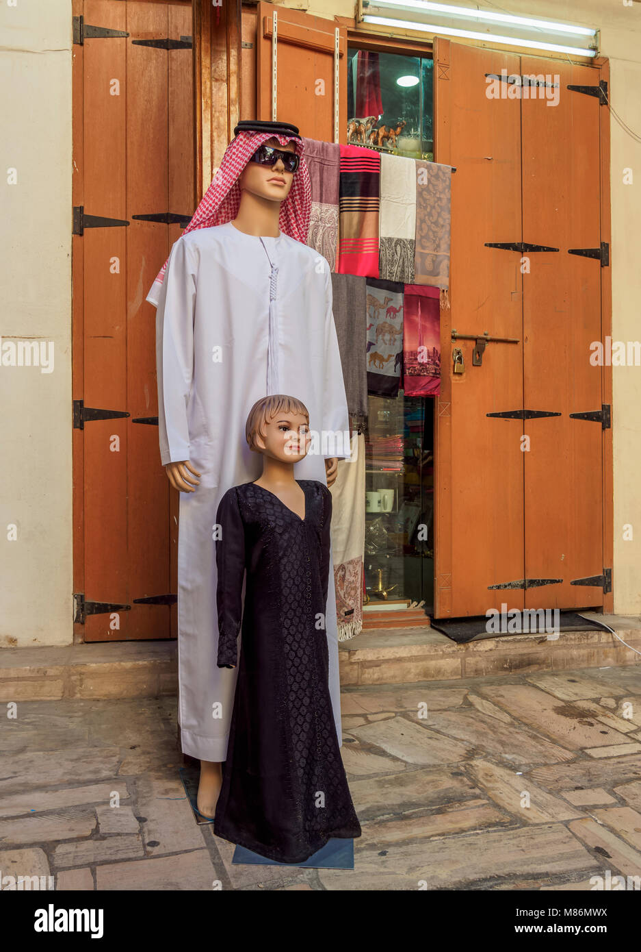 Traditional Clothing sold on the souk, Deira, Dubai, United Arab Emirates - Stock Image
