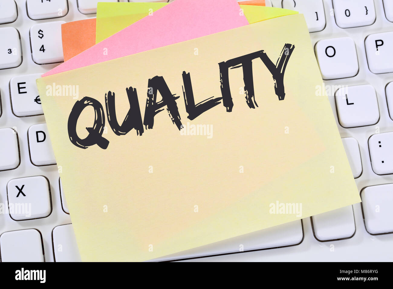 Quality control management success business concept successful note paper computer keyboard - Stock Image