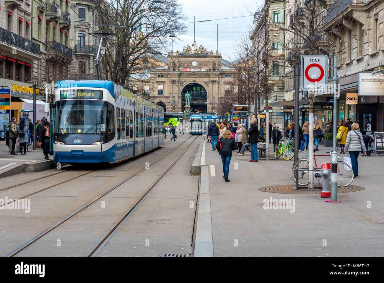 Bahnhofstrasse, Zurich, Switzerland with tram and shoppers - Stock Image