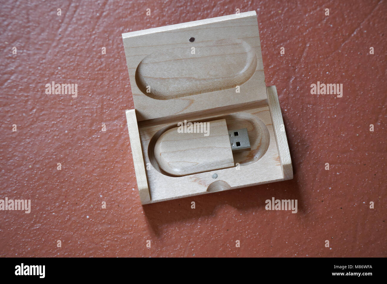 Usb flash drive with wooden surface in wooden box on desk for USB port plug-in computer laptop for transfer data - Stock Image